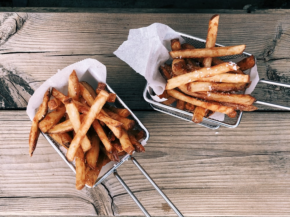fried fries on white paper