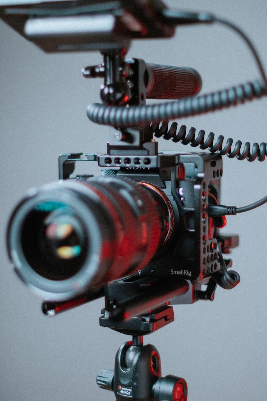 black and red nikon dslr camera