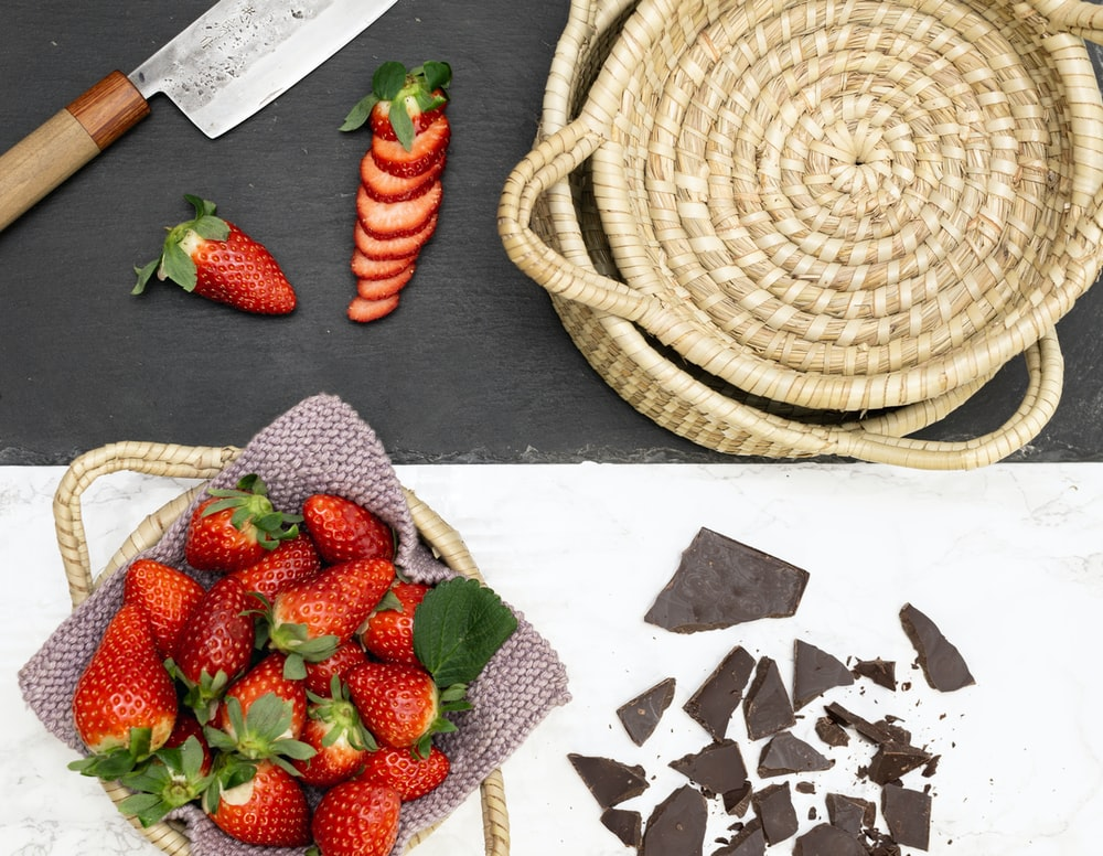 strawberries on brown woven basket