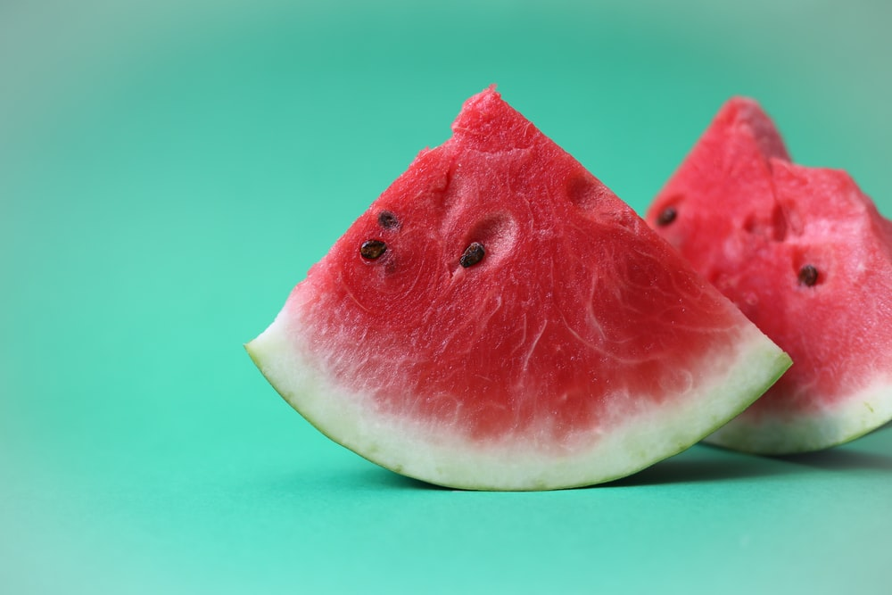 sliced watermelon on green surface