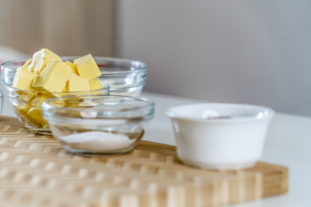 yellow flower on clear glass bowl