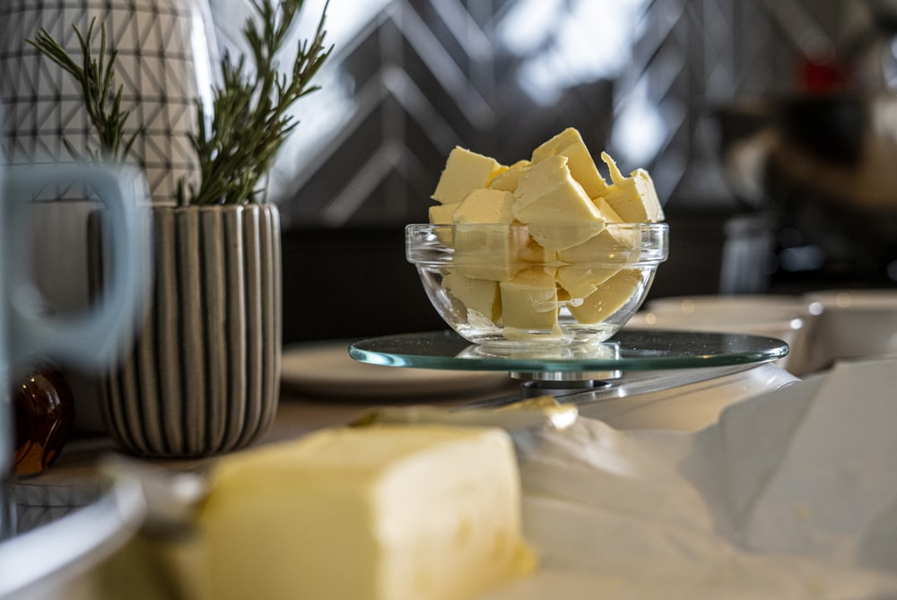 yellow cheese on green and white ceramic plate