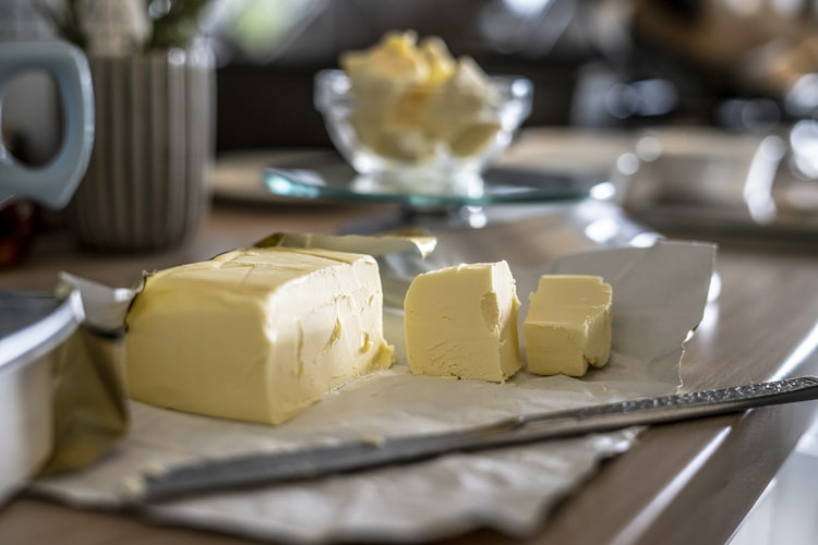 Image of sliced butter sitting on the counter.