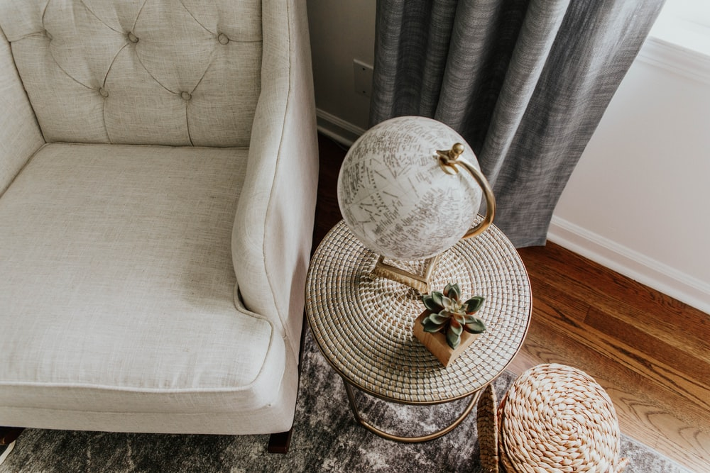 white and gray round table lamp on brown wooden table