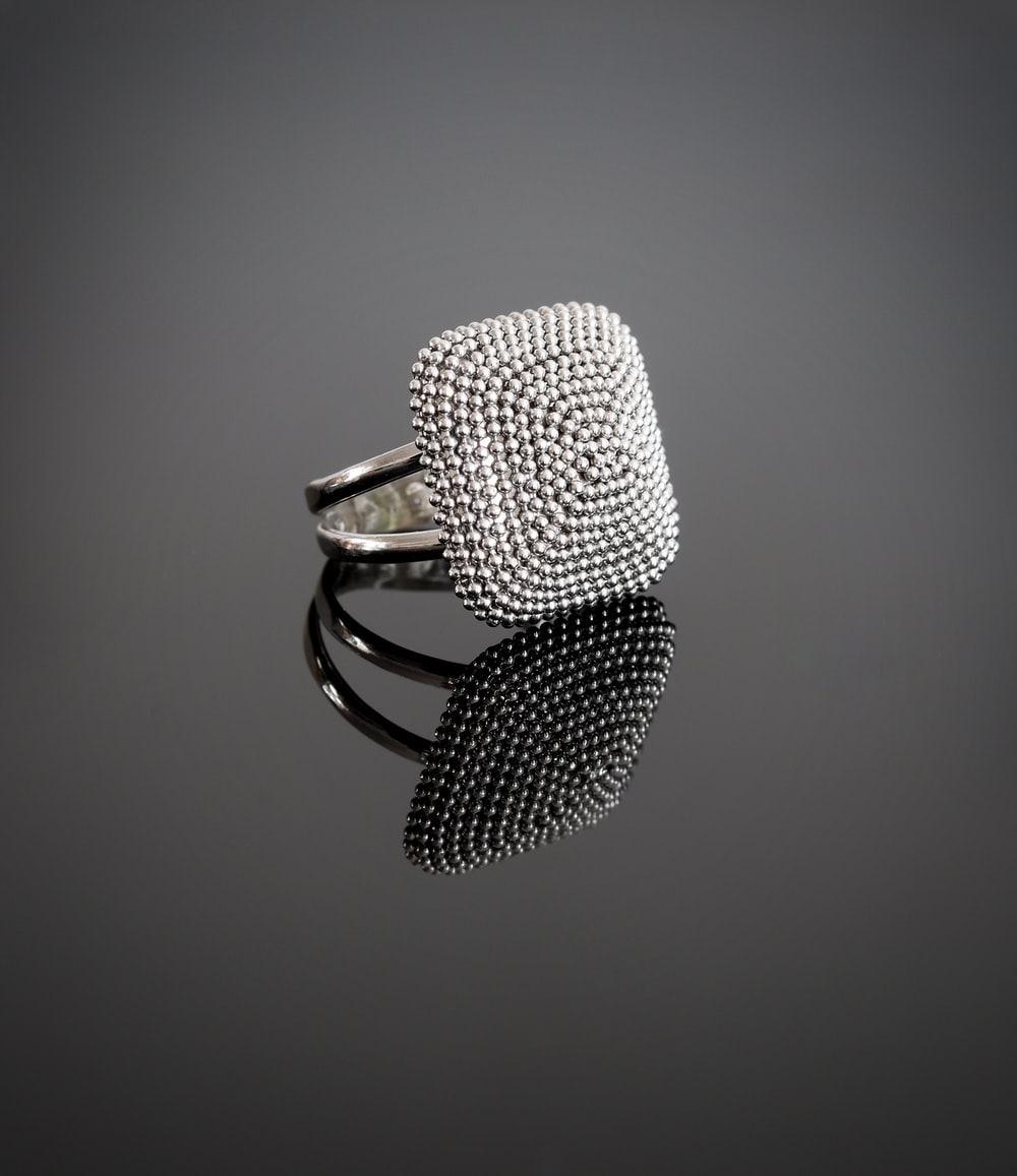 silver and black microphone on white surface