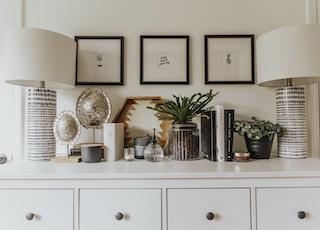 white desk fan on white wooden cabinet