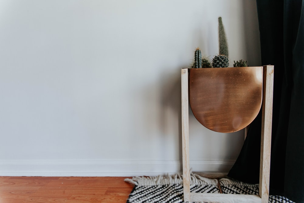 brown wooden chair on gray and black area rug