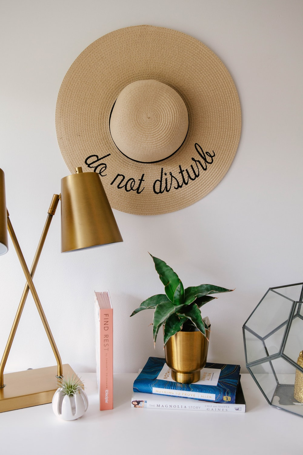 brown sun hat beside green potted plant