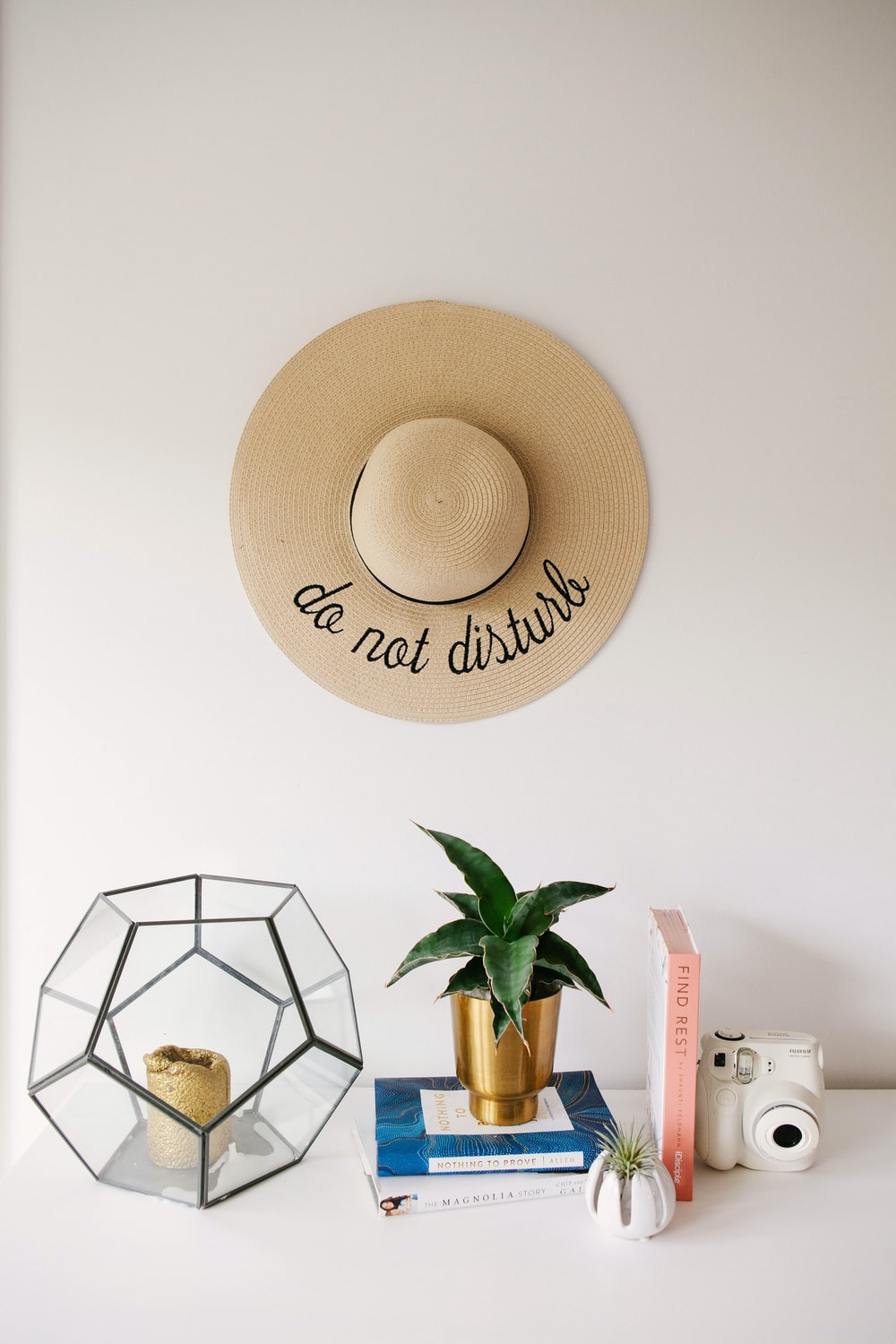 brown hat on white table