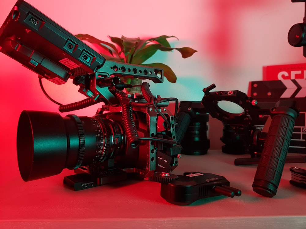 black dslr camera on red table