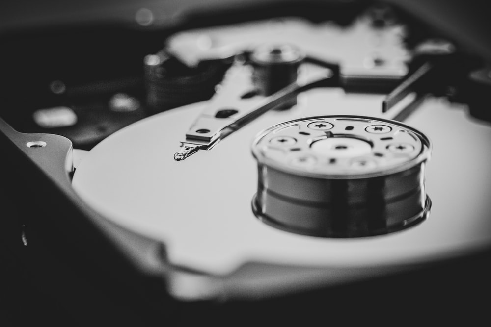 white and black turntable in grayscale photography