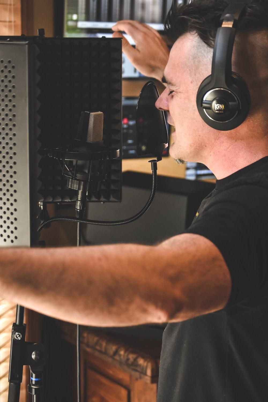 man in black t-shirt wearing black headphones