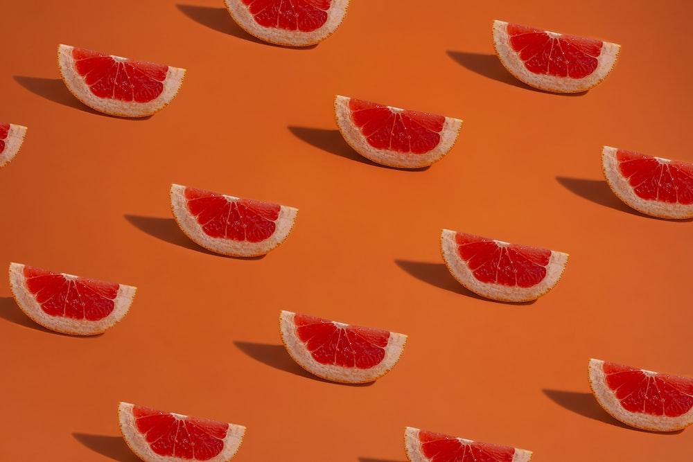 orange and white floral textile