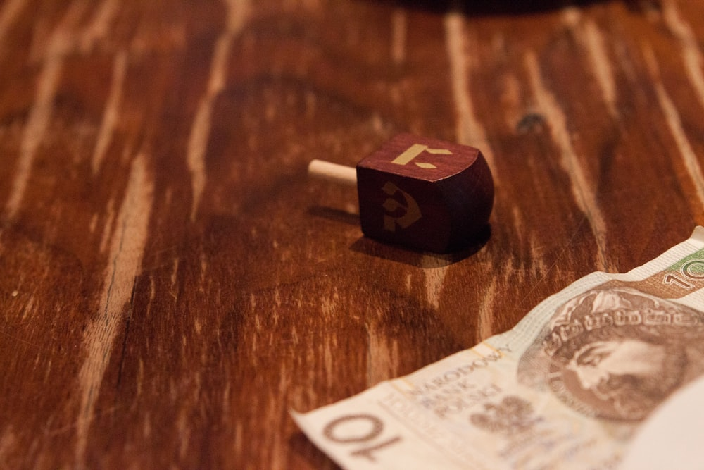 10 banknote on brown wooden table