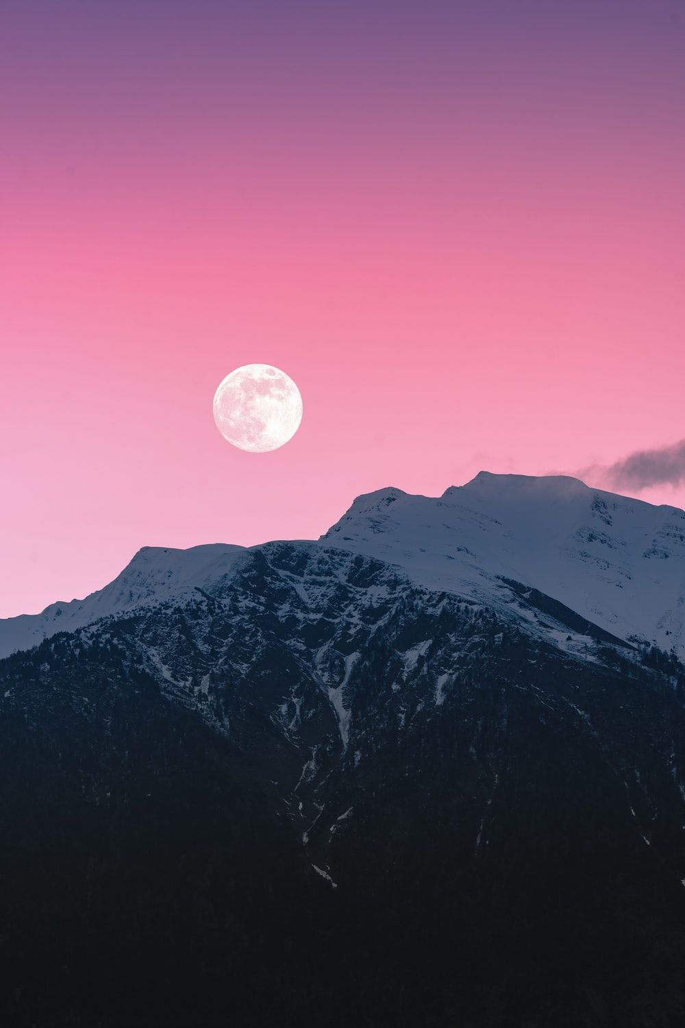 snow covered mountain under full moon