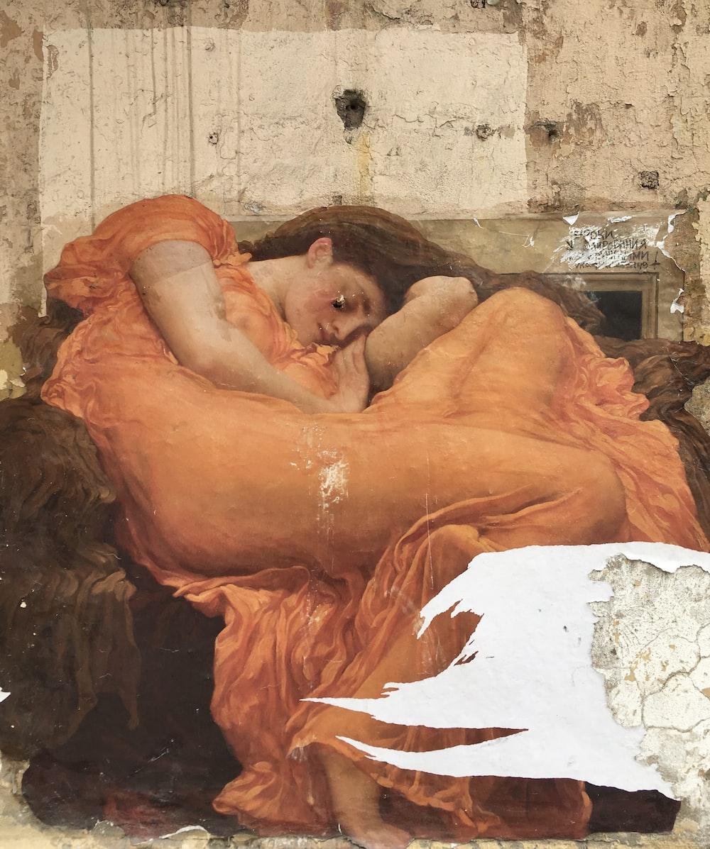 woman lying on white textile