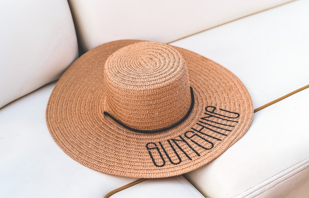 brown straw hat on white table