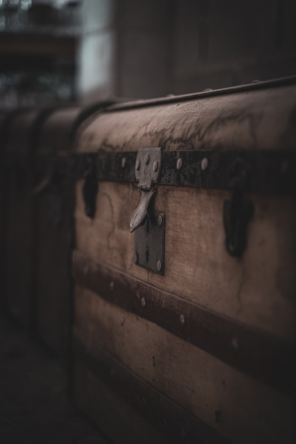 brown and black suitcase in close up photography