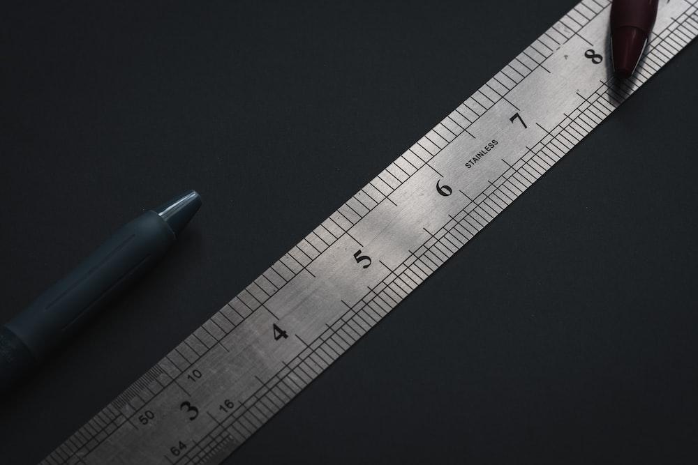 blue pen on black surface