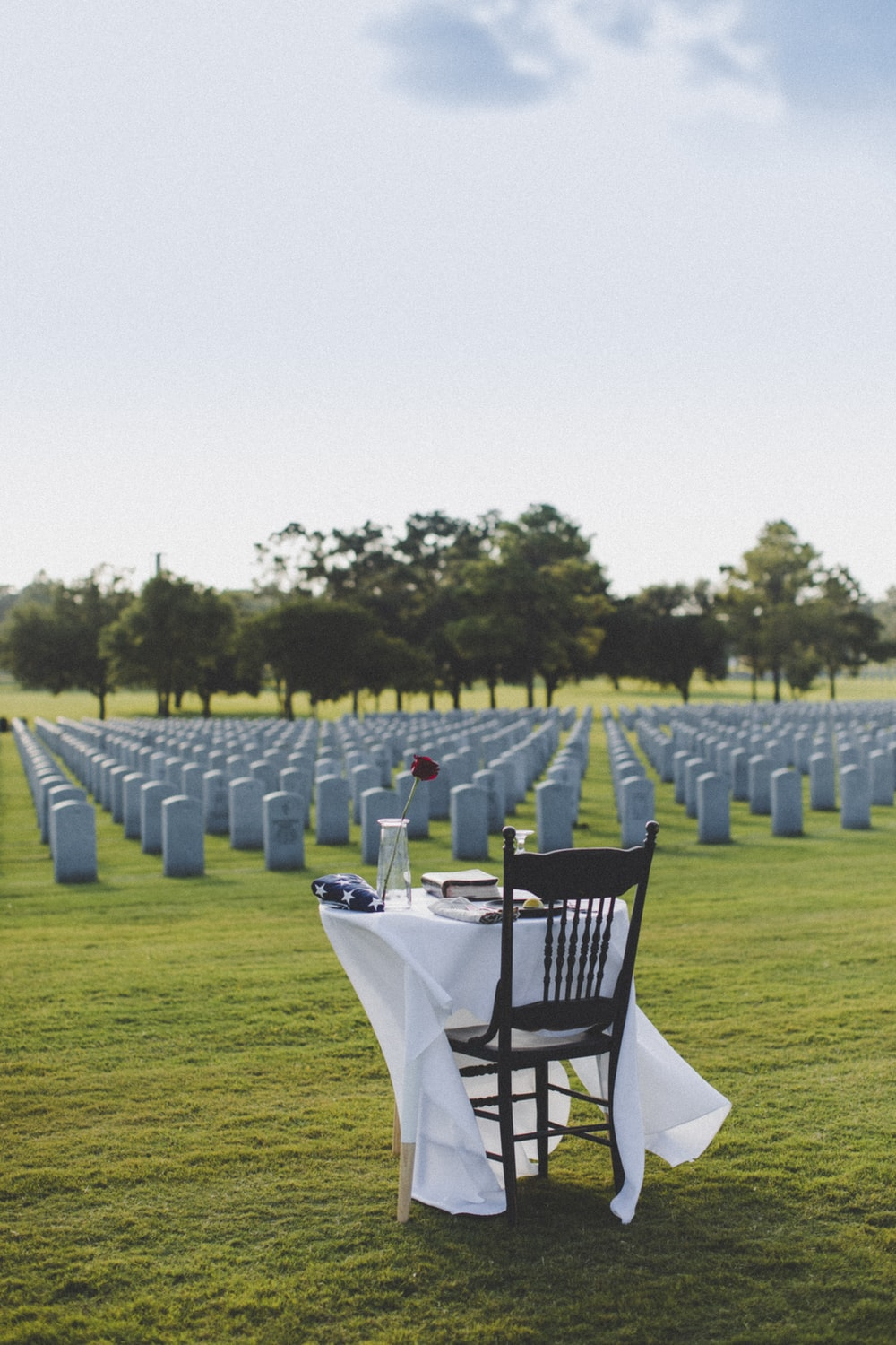 white table and chairs on green grass field during daytime