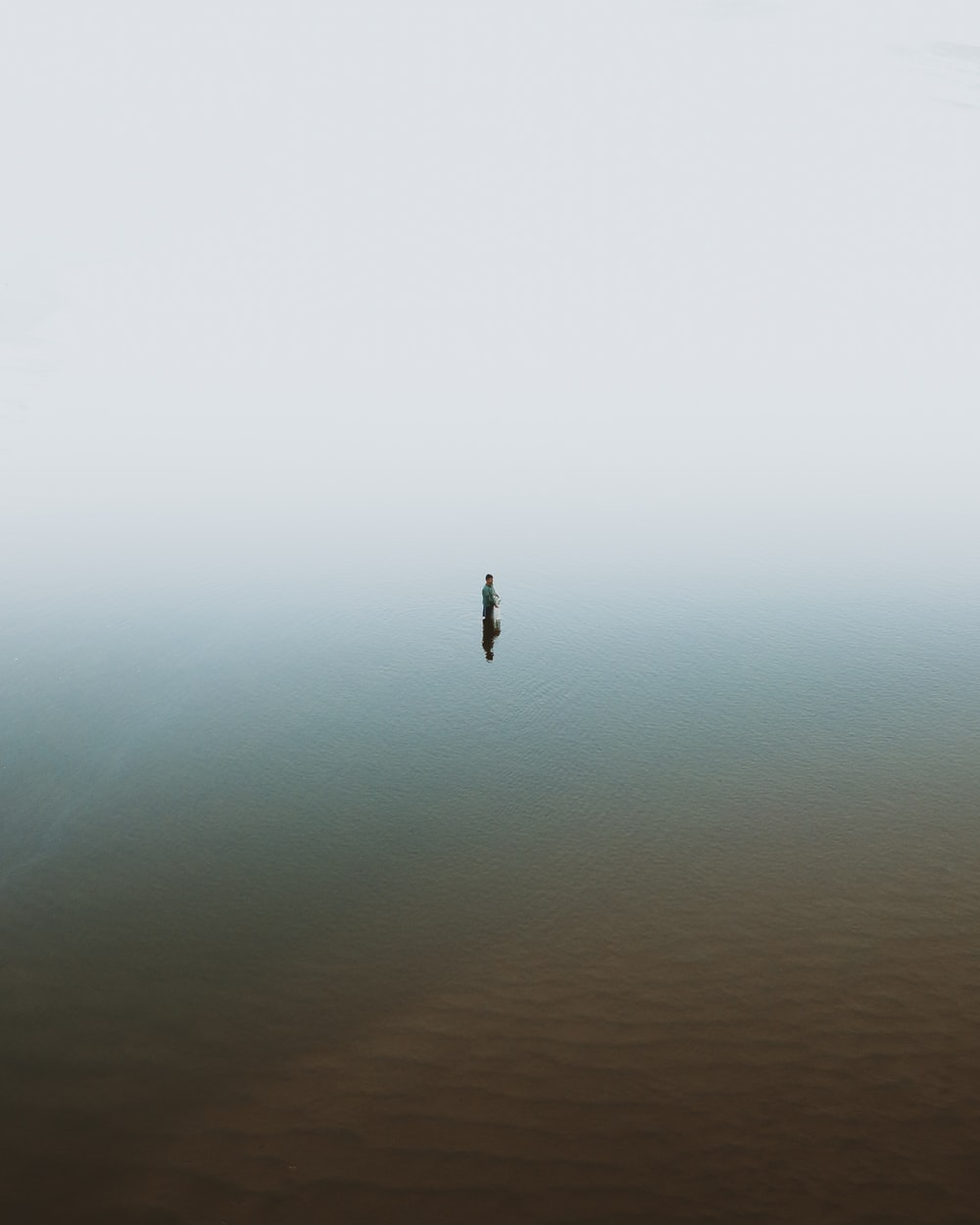 person in body of water during daytime