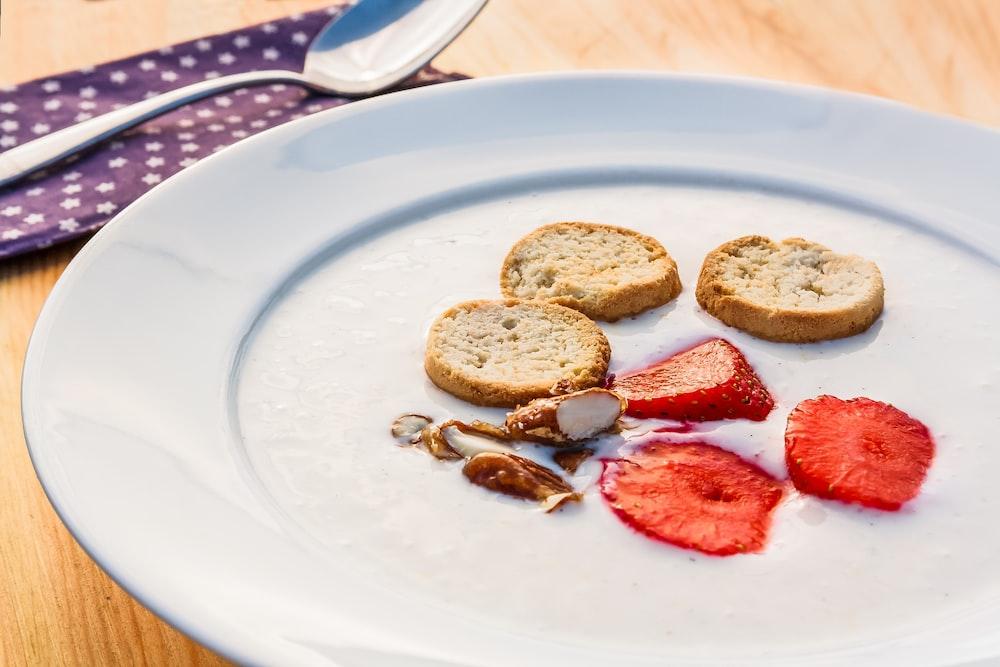 sliced strawberries on white ceramic plate