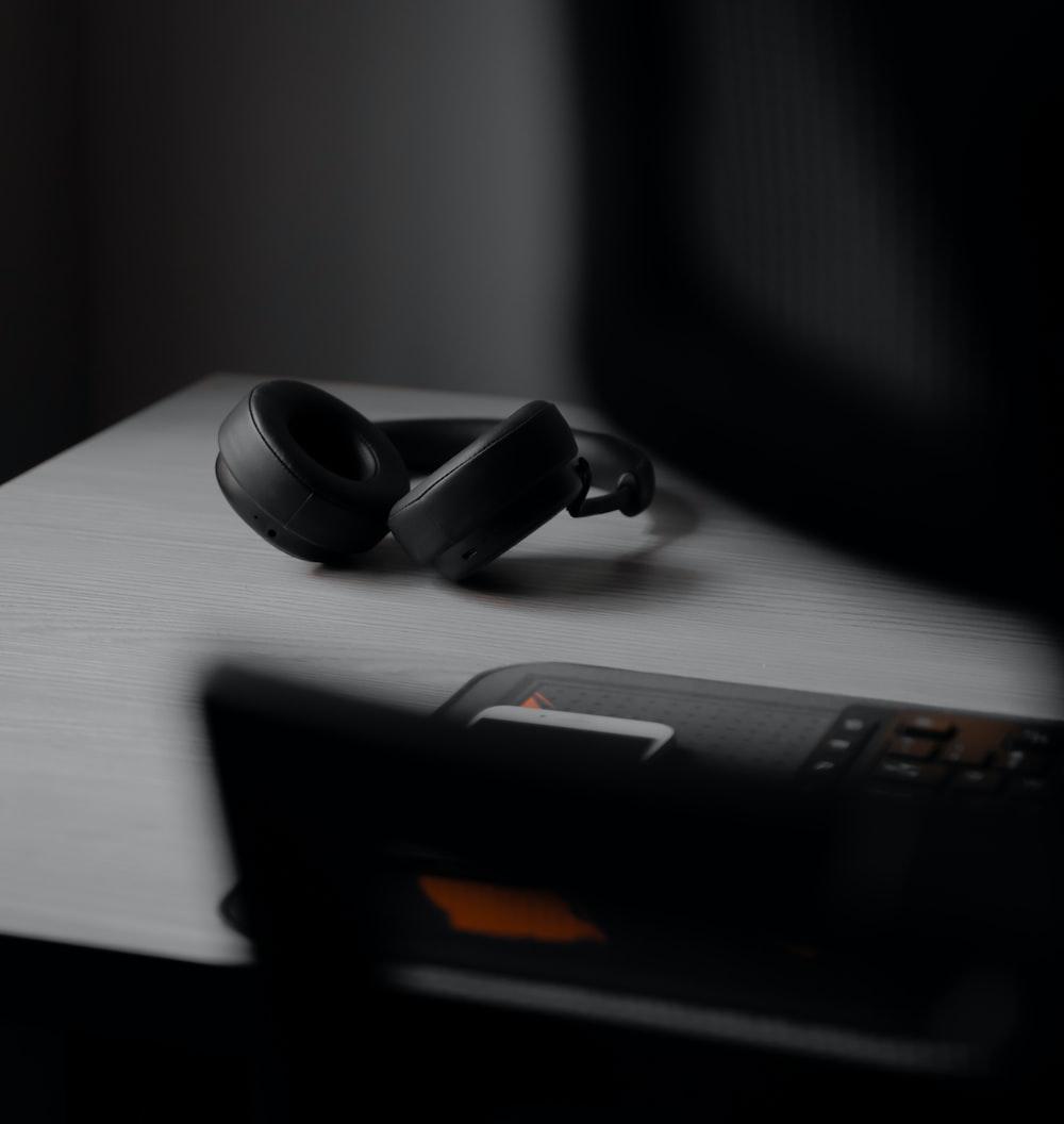 black dslr camera on black laptop computer