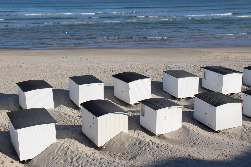 white concrete building on beach shore during daytime