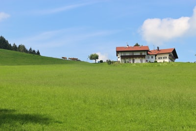 Idyllic countryside in Bavaria, Germany. Mountain pasture, house and cattle. Near Ainring, Berchtesgadener Land.