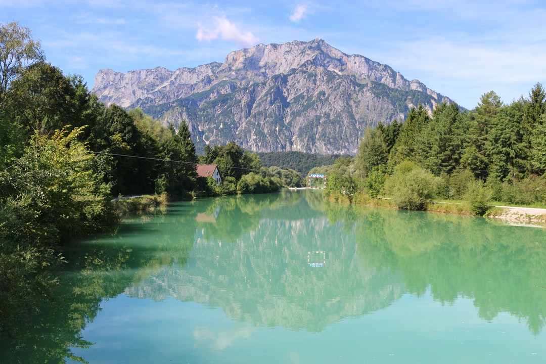 Beautiful landscape with the Salzach river, in the background the mountain Untersberg. A goal for canoe polo is placed in the middle of the river. Puch, near the city Salzburg, Austria.