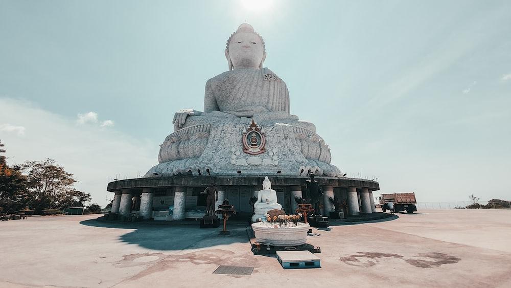gray concrete buddha statue under blue sky during daytime