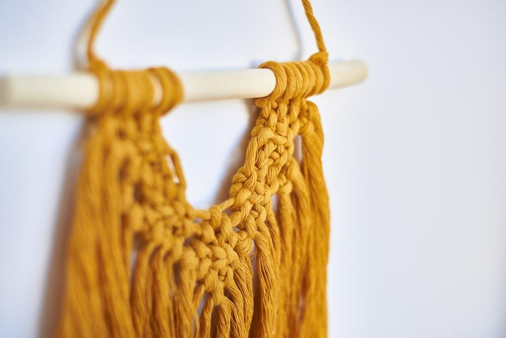 orange knit v neck shirt