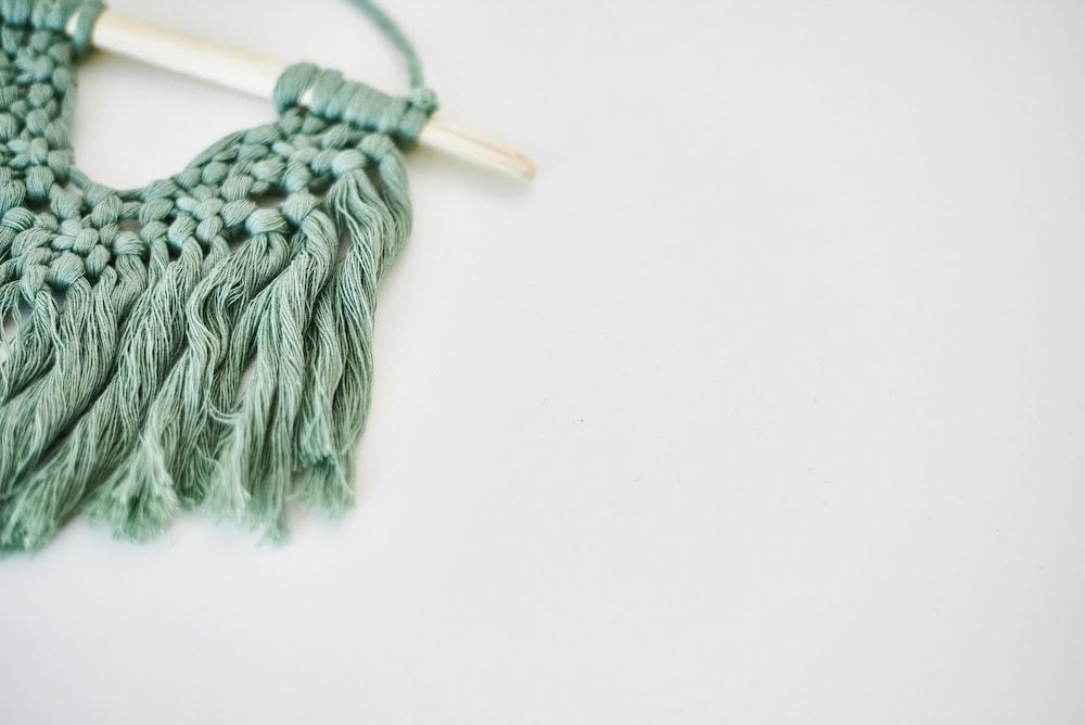 gray yarn on white surface