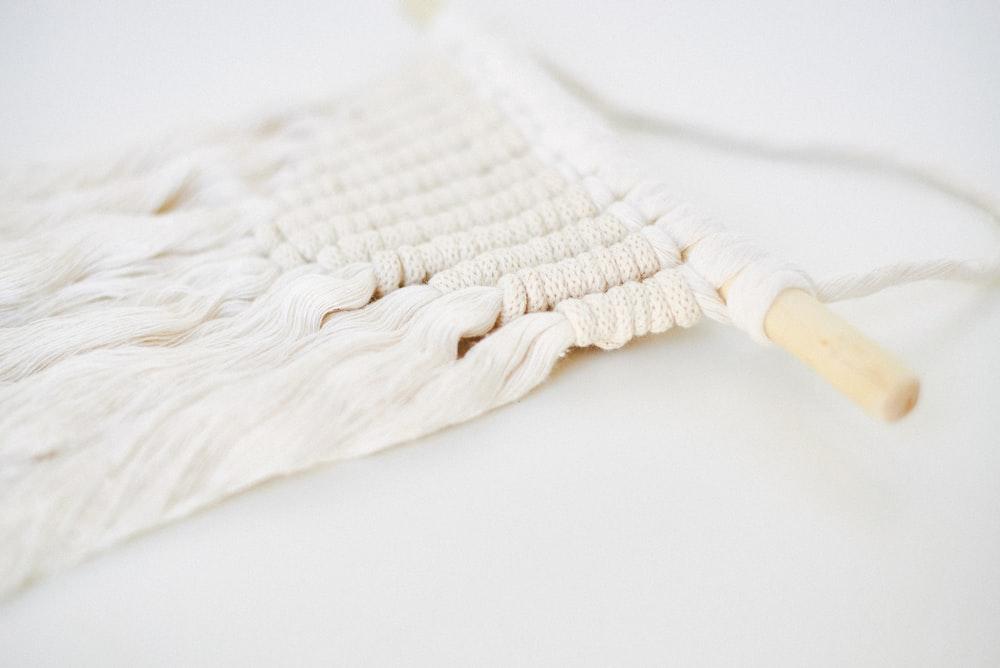 white textile on white table