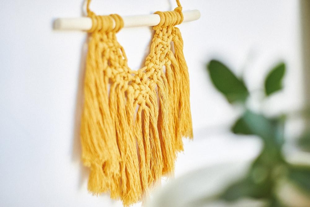 yellow knit v neck shirt