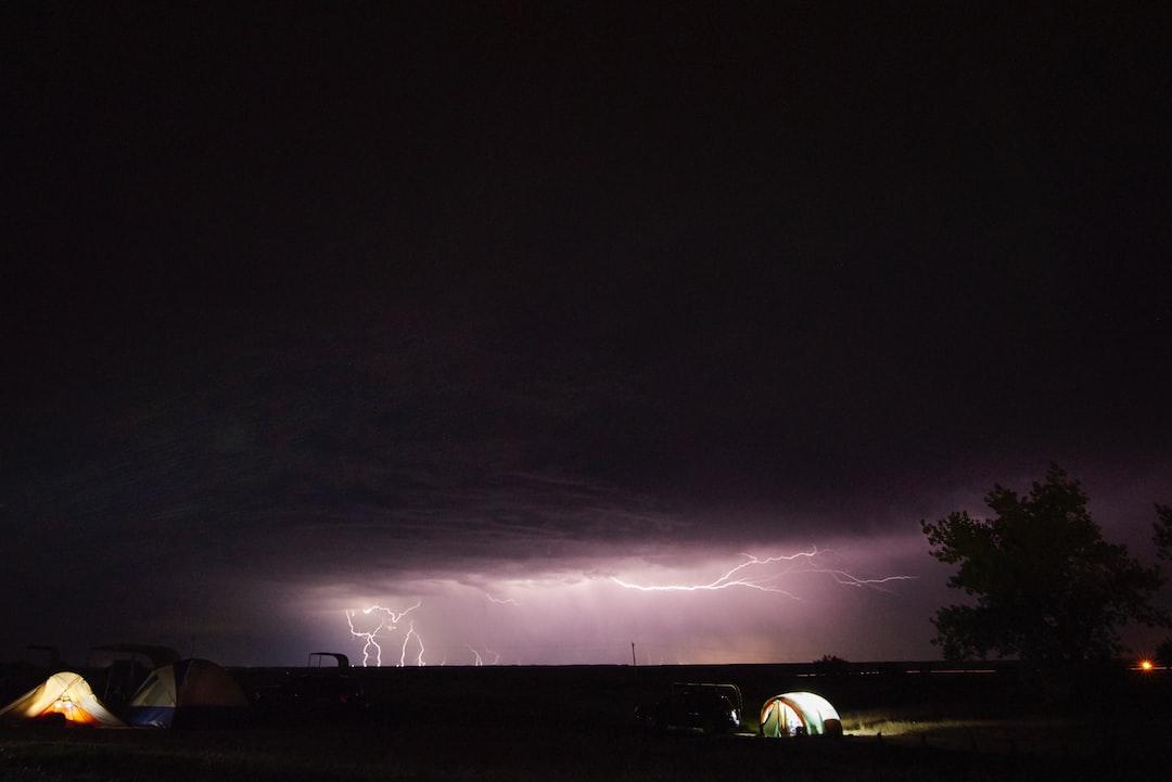 A lightening display above a campsite in Badlands National Park.