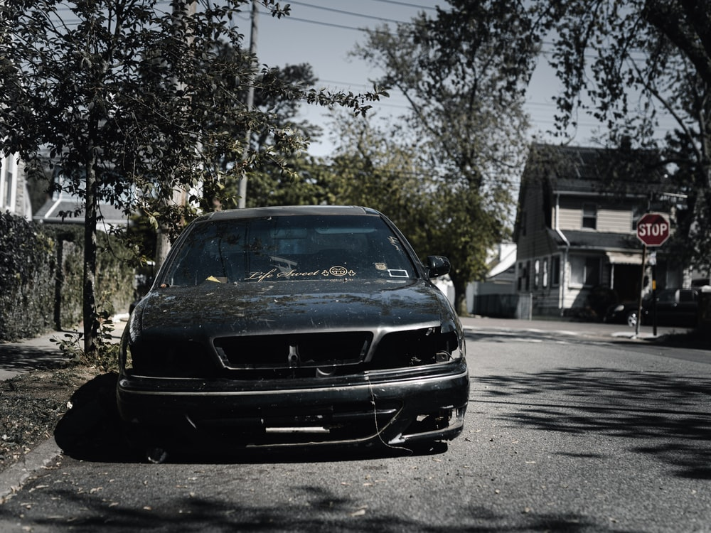 black car parked on the side of the road