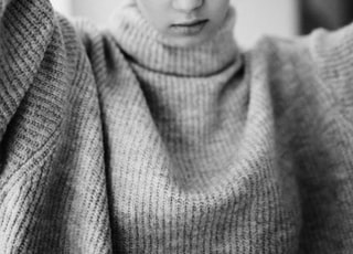 woman in gray knit sweater