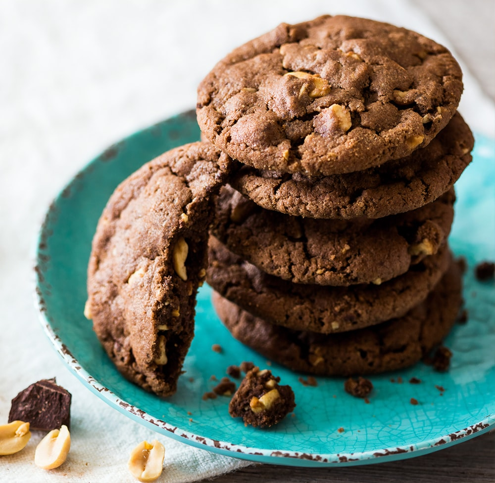 brown cookies on blue and white ceramic plate