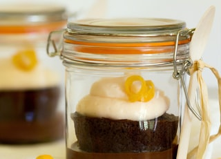 chocolate cake on clear glass jar