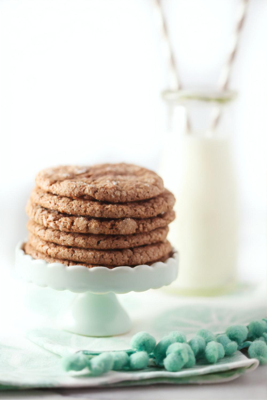 three cookies on white ceramic plate
