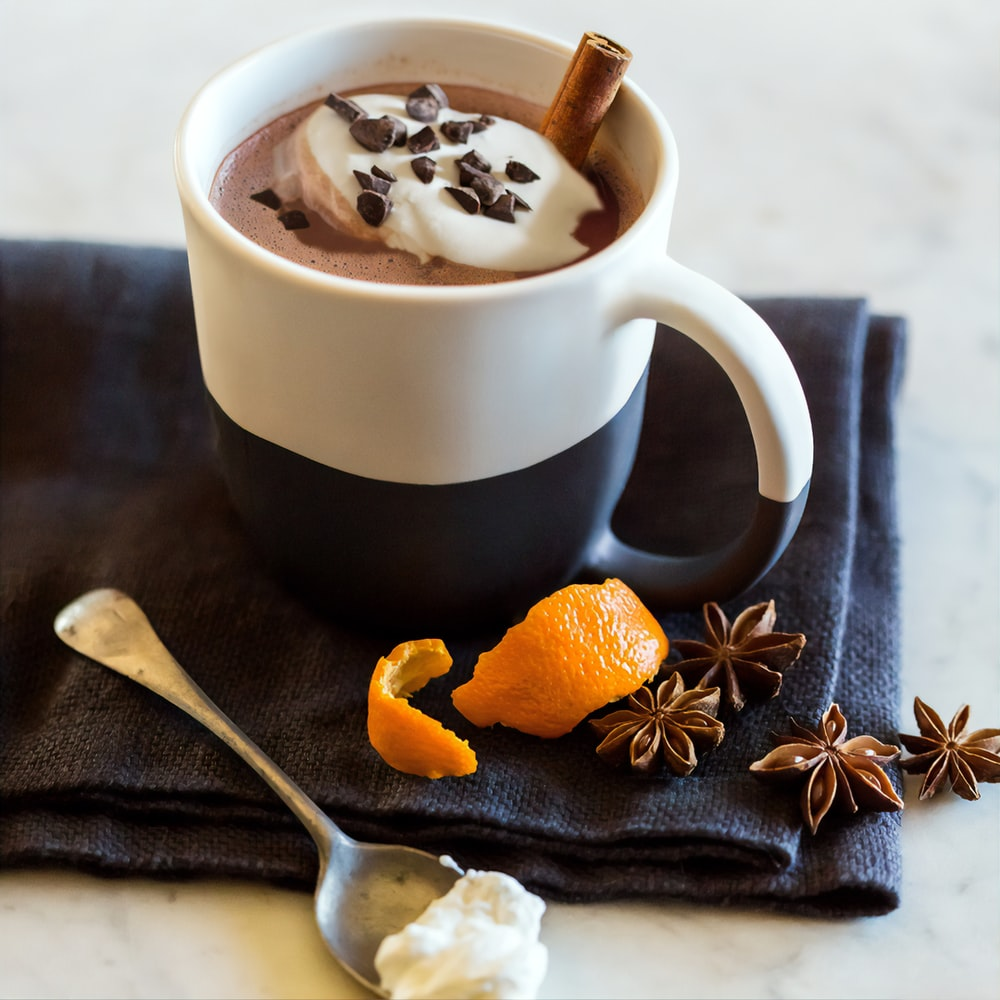 white ceramic mug with brown and black liquid