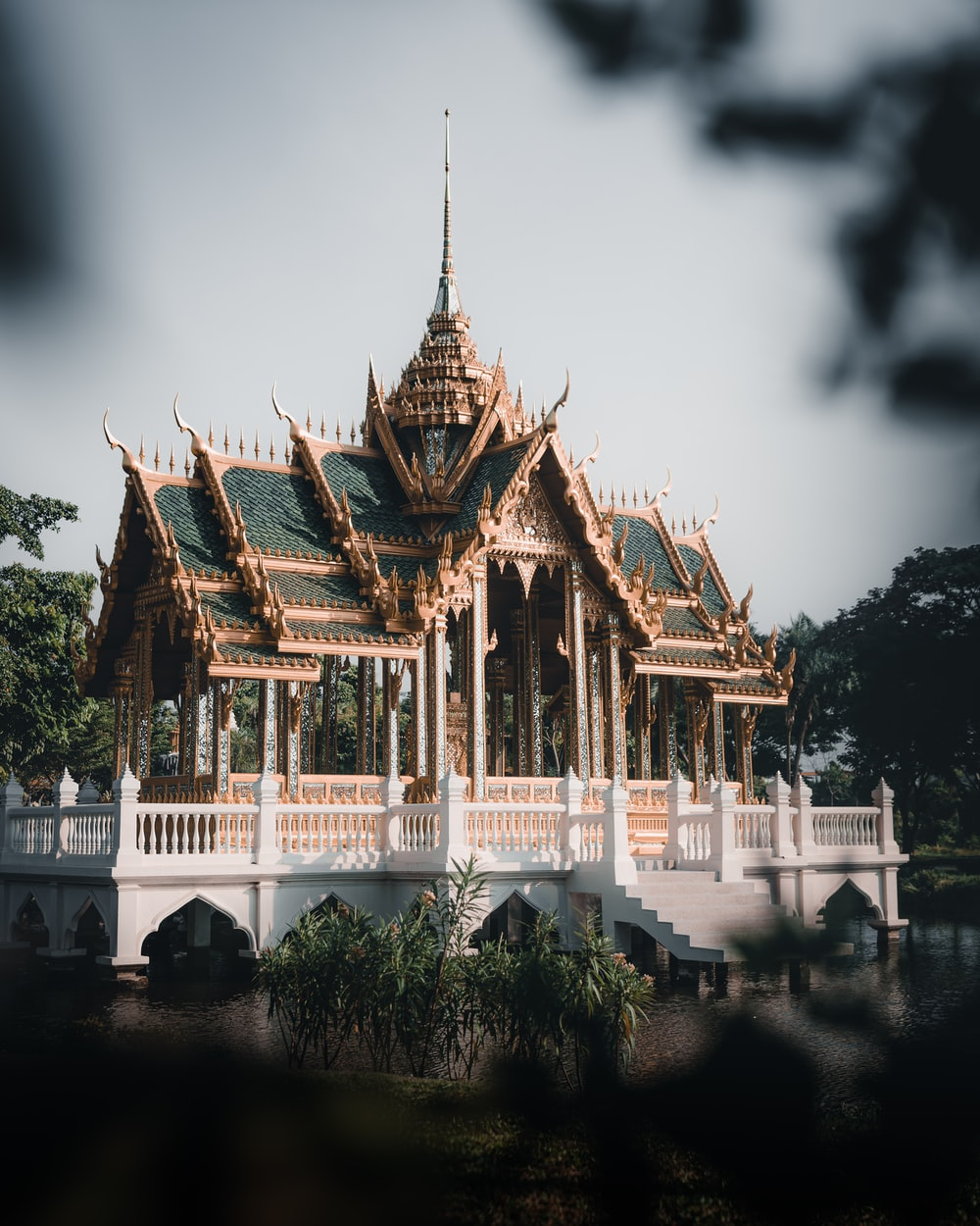 white and brown temple near body of water