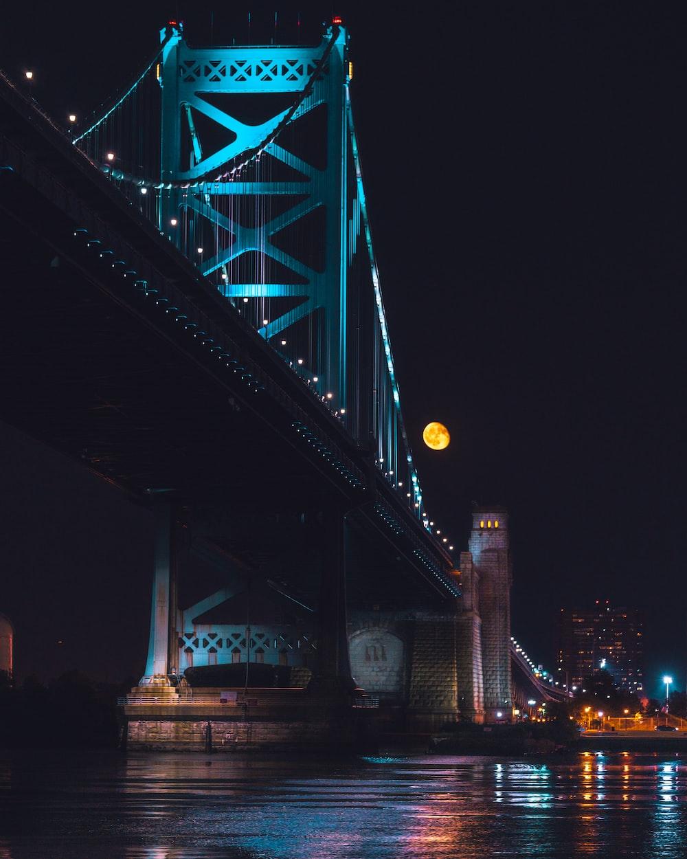 lighted bridge during night time