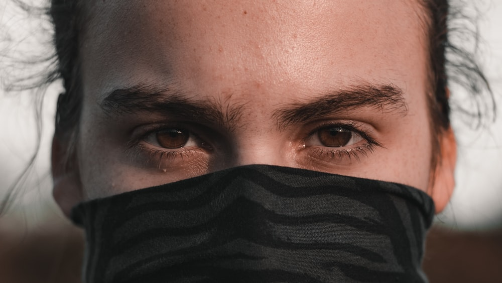 persons face with black textile