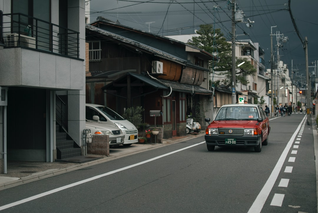 An old car on a small street in Kyoto, Japan.