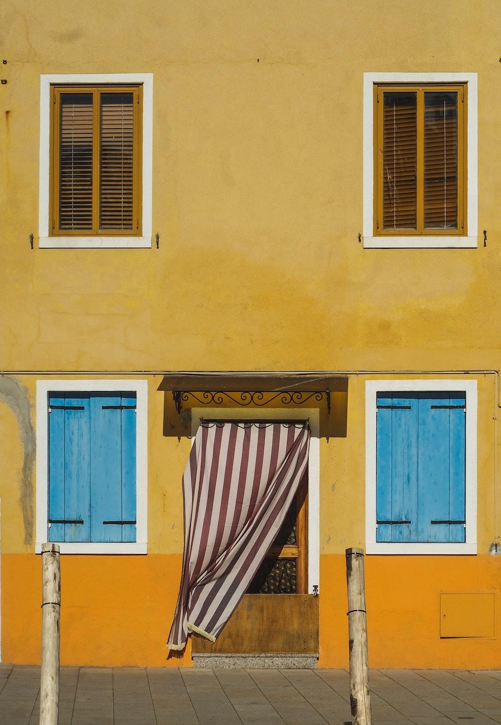 blue wooden door on yellow concrete building