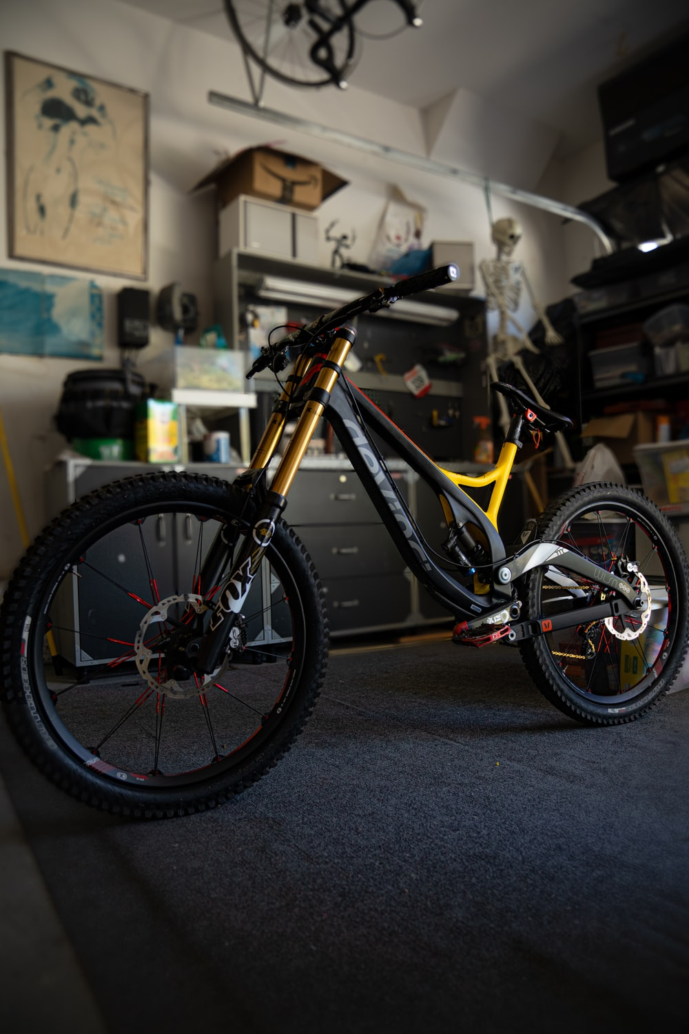 yellow and black full suspension mountain bike