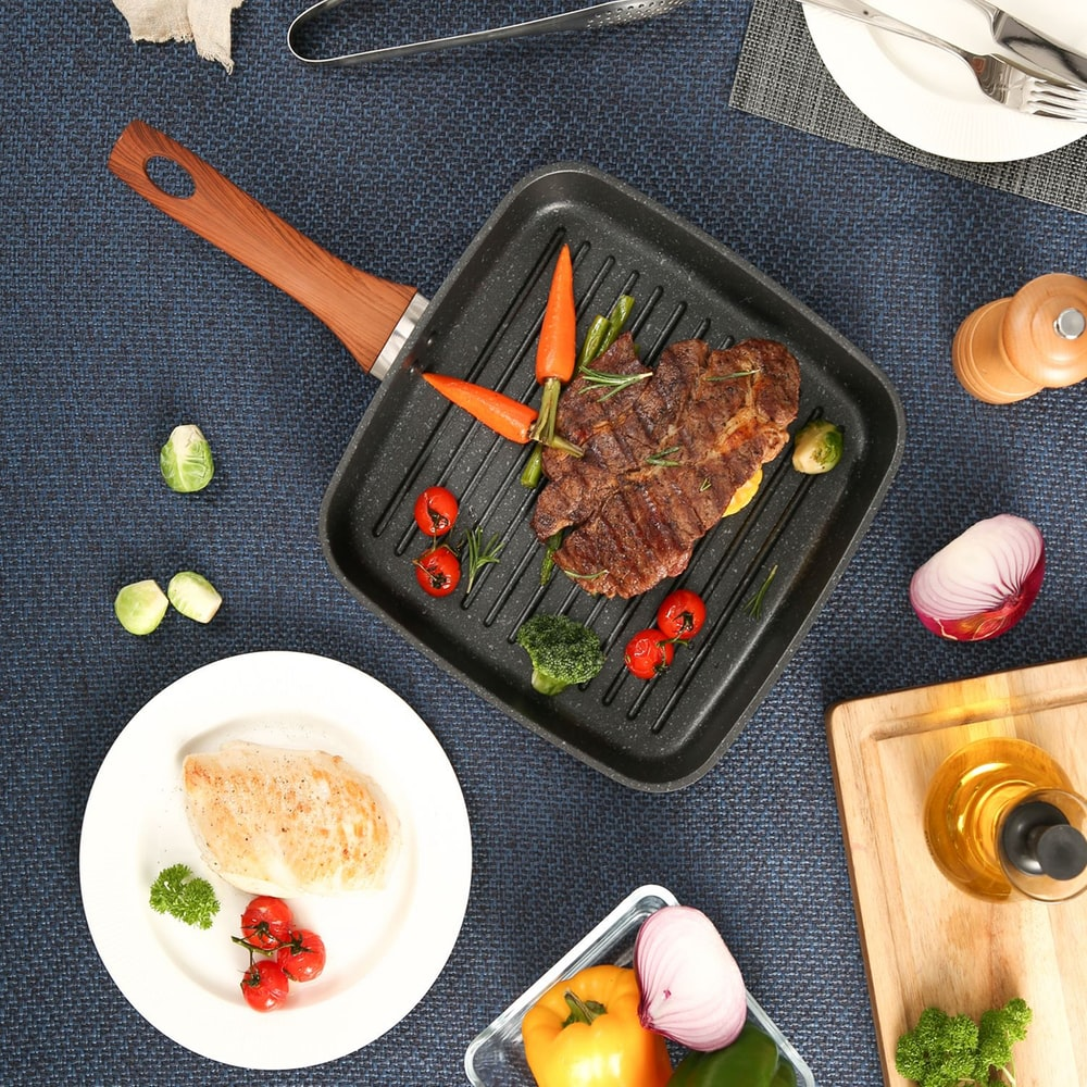 cooked meat with sauce on black rectangular tray