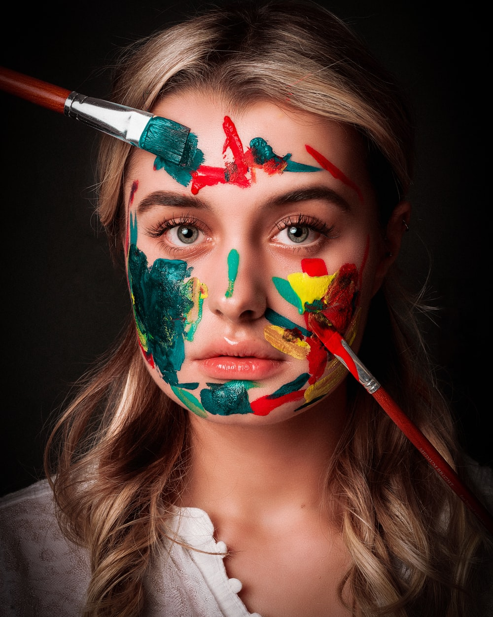 woman with red green and yellow face paint